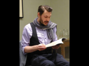 Poet Marcas Mac an Tuairneir reading from the new collection