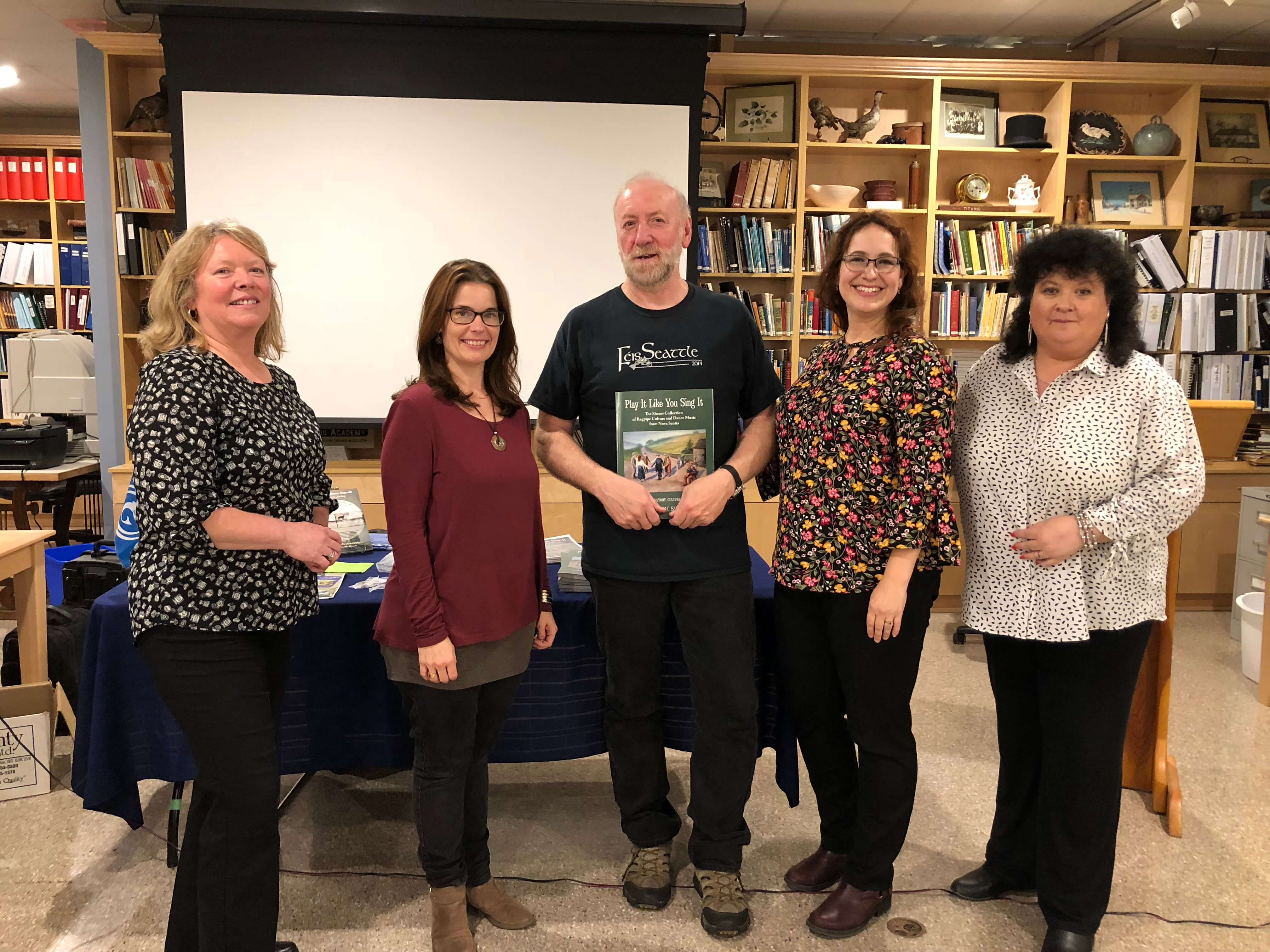 Book launch performers and organizers at McCulloch House Heritage Centre in Pictou, NS. L to R: pianist Lorna Kennedy, fiddler Heather Cameron, Barry Shears, Emily McEwan, and Cathy Ann MacPhee